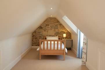Twin bedroom in the loft of the main house, accessed by paddle style stairs