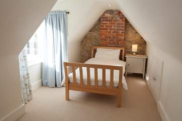 The second bed in the twin loft room of the main house