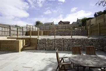 Fully enclosed patio with two levels of garden, which includes a petanque court
