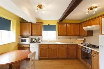 Large well equipped kitchen with dining area