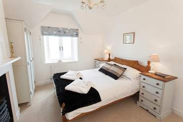 Get a good night's sleep in the lovely double bedroom with views out to sea.