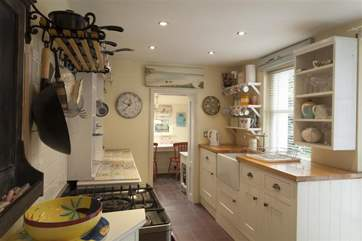 The modern kitchen features a belfast sink and comes fully equipped.