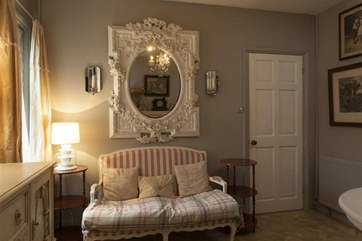 The art-deco style throughout the house is shown in the attention to detail even in the mirror.