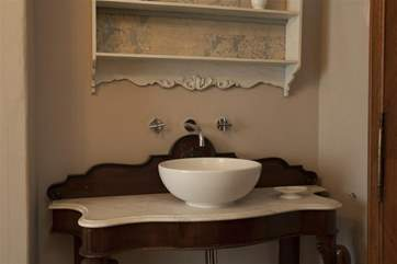 An old style with a contemporary twist. Everything you could need in the bathroom.
