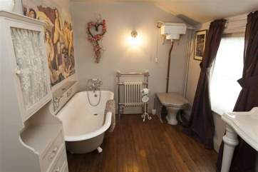 In the bathroom, Victorian decor meets modern luxury.