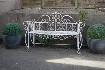 The beautiful cast iron seating in the courtyard garden.