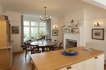 The large kitchen has a circular table with comfortable seating for 8.
