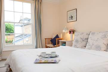 The double bedroom boasts simple but delightful decor.