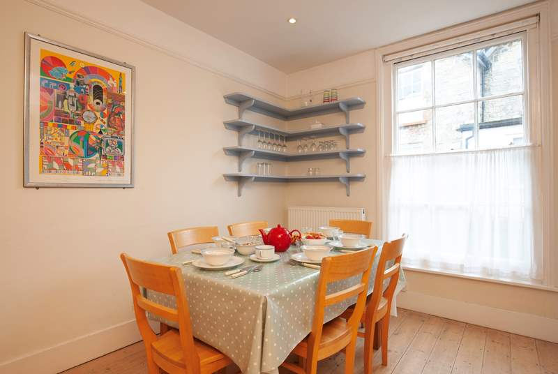 The bright, charming dining area in the kitchen makes meals a pleasure.