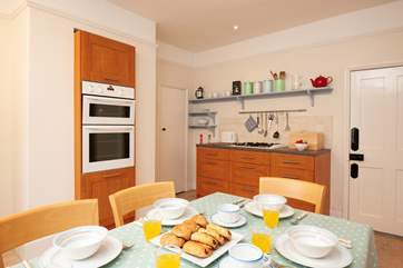 The eat-in kitchen is spacious and well-equipped.