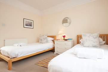 There's also a comfortable twin room with plenty of storage.