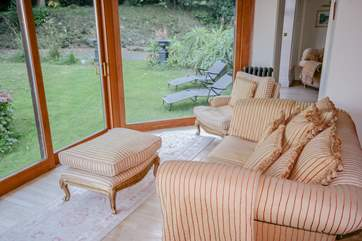 Sitting area with views across the garden and out to sea