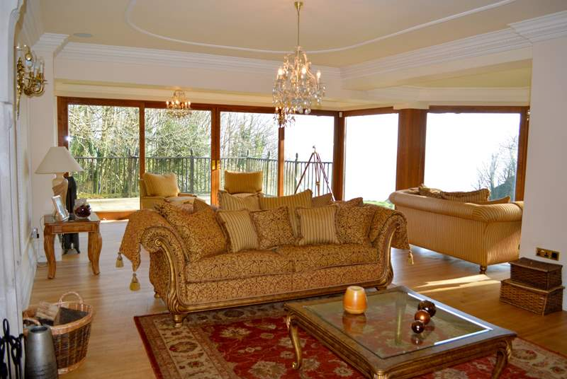 Large living area which leads onto decking with Sea views