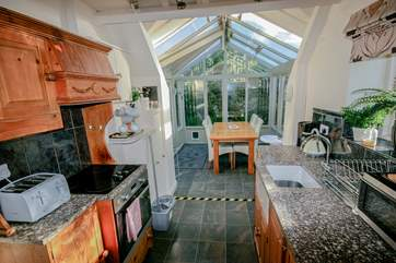 Kitchen through to conservatory dining area