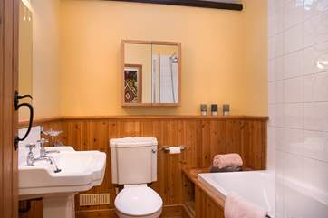 Lovely bathroom, with an inviting bath perfect to relax in after a fun packed day, accompanied by over-head shower.