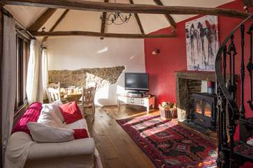 The dining and living area provide a comfortable and spacious place to sit back and cosy up in front of the rather large wood-burner.