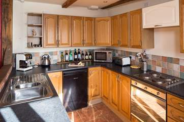 The compact and well-equipped kitchen which leads through to the bedroom.