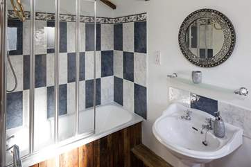 En suite fully fitted with shower over, and a bath, perfect for relaxing in after a full day of exploring this wonderful countryside.