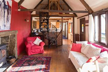 The bright and airy open plan living area. Please take care when using the spiral staircase.
