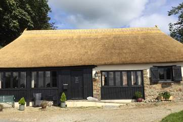 The Old Coach House is simply stunning, especially with its new thatch.