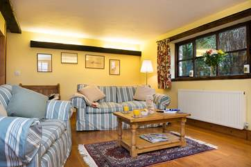 A cosy and comfortable living area, perfect for cosying up and relaxing in.
