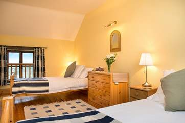 Delightful twin bedroom. Bright and spacious, with wonderful views over the rolling countryside which is your back garden.