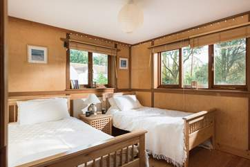 The twin bedroom is furnished with three foot single beds.
