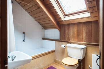 The top floor bathroom has a bath and electric shower, the second bathroom is on the ground floor.