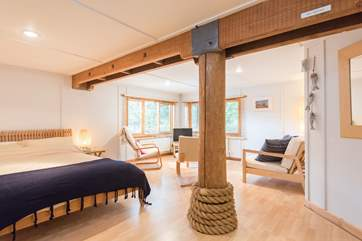 The whole of the ground floor is a large open plan living/sleeping room with a double bed an en-suite bathroom and its own access.