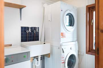 The utility room with washing machine, drier and useful sink is on the ground floor.