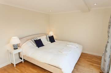 Master suite with doors out to rear balcony and lovely views over the Seaview Nature Reserve.