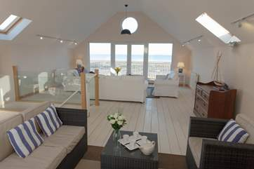 The living-room fills the whole top floor of Mariners with stunning sea views.