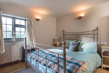 Dual-aspect bedroom 1 is furnished with a 6ft double bed.