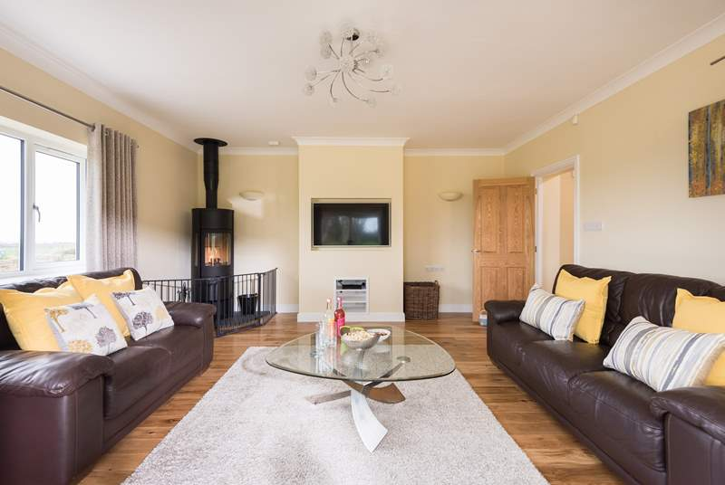 Relax in front of the TV, play games or read a book in the comfy sitting-room.