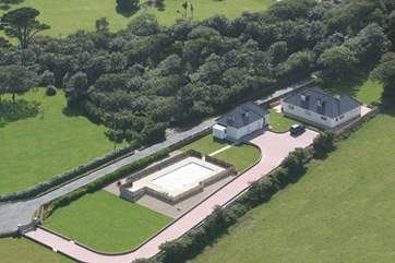 An aerial shot shows the full size of the house, large gardens and that swimming pool!
