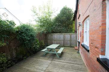 Side decking area with garden furniture