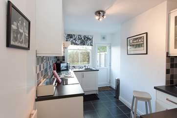 The kitchen is modern and fully equipped with everything you will need