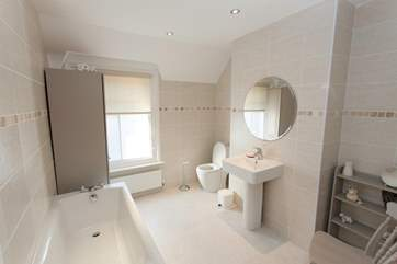 The family bathroom is both spacious and modern