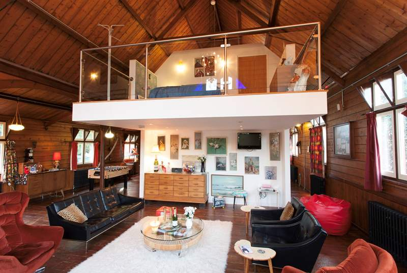 Living area with mezzanine level bedroom above