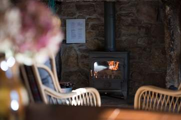 Cosy and warm, relax by the wood-burner.