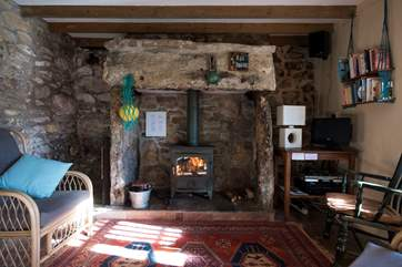A roaring wood-burner in the sitting-area.