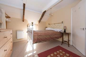 The double bed in the family bedroom.