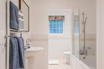 The family bathroom has a bath with shower attachment over as well as a separate shower cubicle.