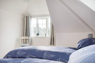 The first floor bedrooms are light and relaxing.