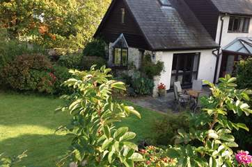 The sitting-room overlooks the very pretty south-facing garden.