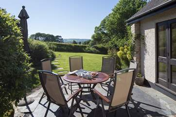 The sheltered south-facing garden is a great place for afternoon tea.