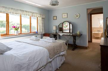 The master bedroom has a 5ft bed, en suite bathroom and views out over the pretty gardens.