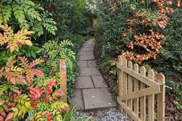 Once parked up, follow this pretty pathway to access your dream holiday cottage.