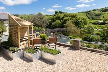 The views are quite simply stunning. There are two lovely seating-areas that make the most of it, at the front of the cottage, just across the little no-through lane. There is a beautiful back garden