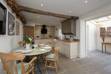 The large kitchen/dining-room has flagstone floors - ideal if you are bringing a dog.
